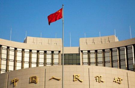 Китайский ЦБ опустил курс юаня к доллару в ожидании пошлин США