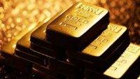 Ослабление доллара притормозило падение цен на золото